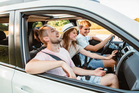 four friends in car navigation on phone