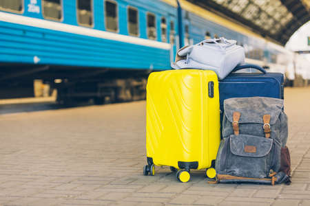 view of bags and suitcases at railway station platform copy space Reklamní fotografie