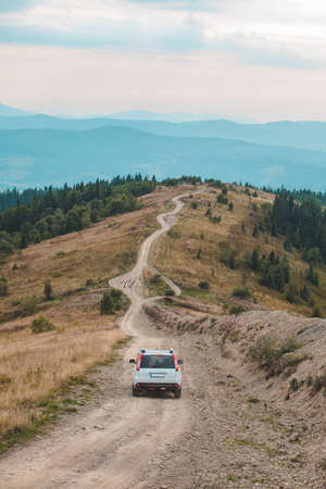 off road car travel by mountains peak autumn season road trip