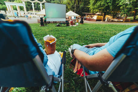 eating snacks drinking beer movie in open air cinema copy space