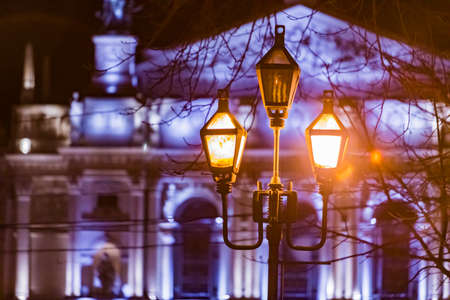 night city street lights old opera building on background copy space Reklamní fotografie