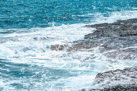 view of rocky seaside waves with white foam. copy space Reklamní fotografie