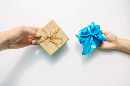 hand giving decorated present box celebration concept copy space