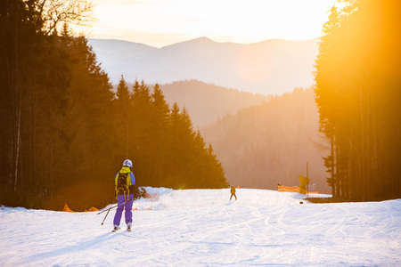 woman skiing on sunset copy space ski resort
