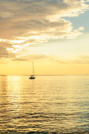 view of sail boat on sunset in bay. summer vacation. copy space