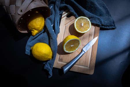 sliced lemons on cut board flat lay fruits