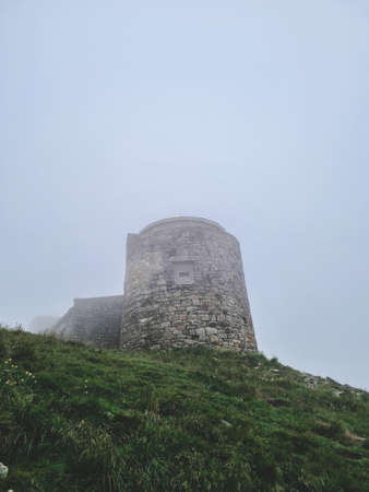 view of old observatory on the top of mountain peak. fogy mist weather Standard-Bild