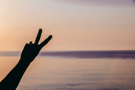 man hand showing different symbol. carefree. freedom