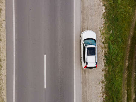 overhead top view of car parked at roadside copy space Standard-Bild