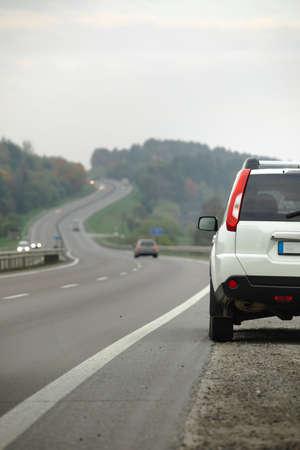 parked car on roadside of highway autumn season