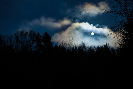 The moon by night in the clouds