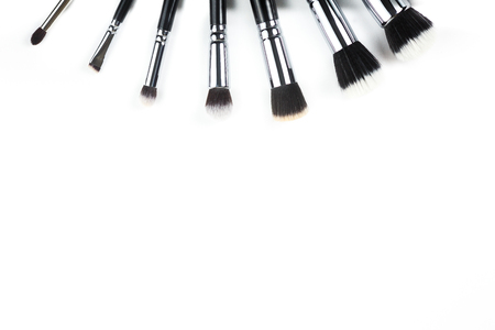 Makeup brushes on white background