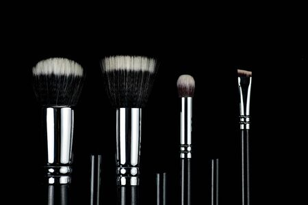 Makeup brushes on black background