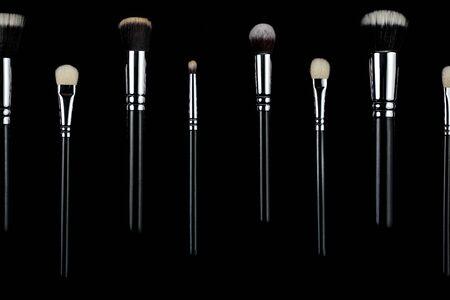 Makeup brushes on black background