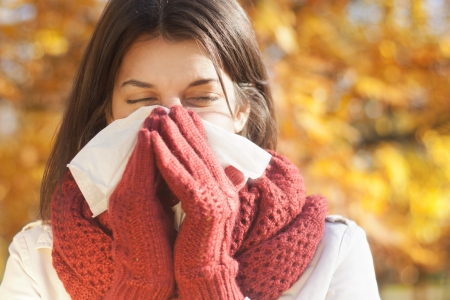 cold woman: Women with tissue having flu or allergy Stock Photo