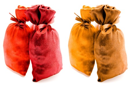 Beautiful multi-coloured sacks made of cloth fastened by a band Stock Photo