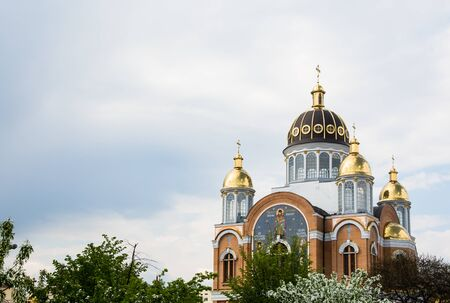 New orthodox church with golden domes in spring, build in 1990s in Kiev, the capital of Ukraine