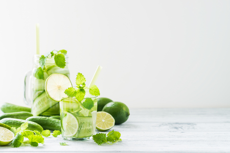 lemon balm: Refreshing drink with cucumber, lime, mint. Detox concept. White rustic table. Copy space Stock Photo
