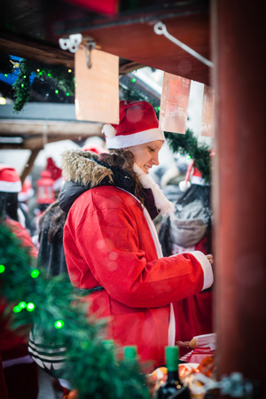 STOCKHOLM, SWEDEN – DECEMBER 11, 2016: Young woman dressed up as santa participates in charity event Stockholm Santa Run in Sweden