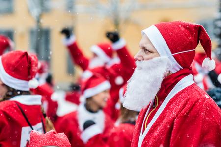 STOCKHOLM, SWEDEN – DECEMBER 11, 2016: Man dressed up as santa participates in charity event Stockholm Santa Run in Sweden 報道画像