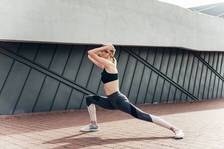 Sporty woman exercising outdoors on steps. 스톡 콘텐츠