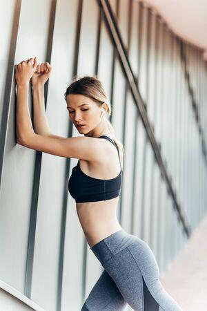 Close up of a female athlete doing warm up exercises.