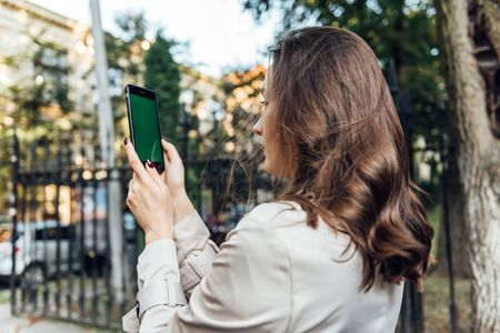 Business woman using smart phone in the city working technology.