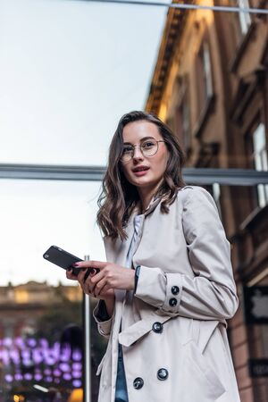 Business woman talking on smart phone. Business people office worker talking on smartphone smiling happy. Young multiracial Asian  Caucasian female professional outside.