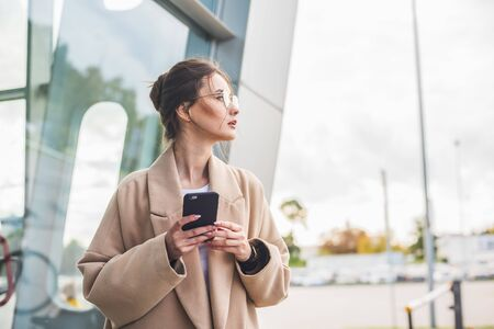 Airport woman on smart phone at gate waiting in terminal. Zdjęcie Seryjne