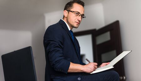 Businessman working, businessman in office, businessman looking at documents