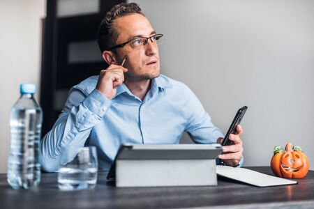 Businessman with eyeglasses working from home