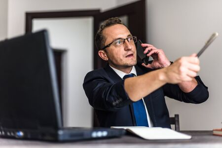 Businessman in office having discussion.