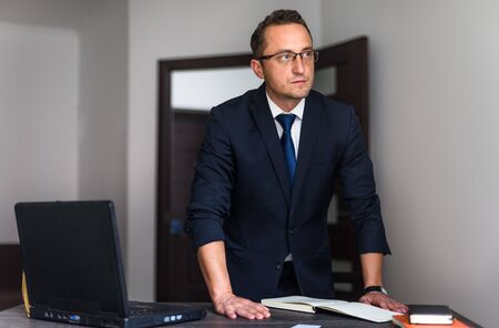 Young businessman working with laptop in an office Foto de archivo