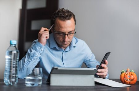 Businessman with eyeglasses working from home.