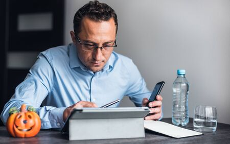 Businessman in the office working on ipad.