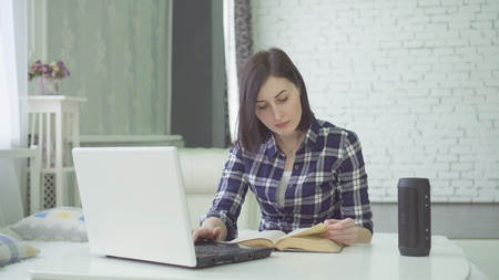 young woman studying, using a voice assistant, has a question