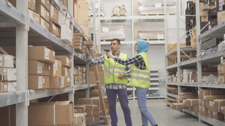 Warehouse workers communicate and carry out accounting scanner barcode