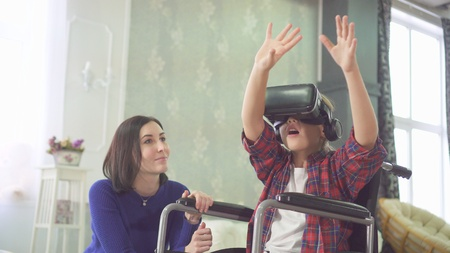 portrait young disabled woman in a wheelchair, uses vr helmet, 3D technology