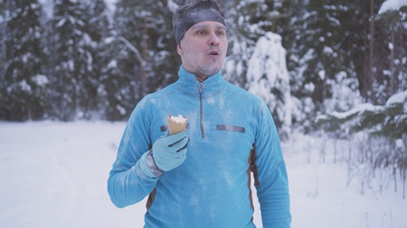 frozen man in the snow, there is ice cream in winter, strong immunity close