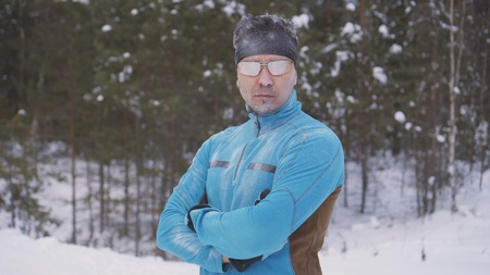 portrait frozen sports athlete man, portrait of an athlete in winter, running in a cold time,winter sports