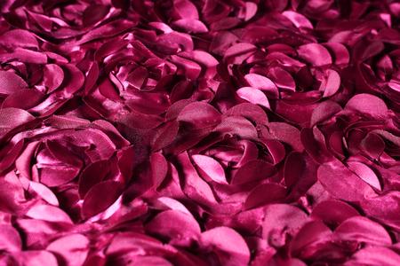 Fabric roses design background texture. Pink purple closeup pattern.
