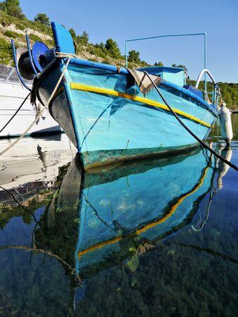 Traditional Greek fishing boats in port Gaios, Paxos Island photo