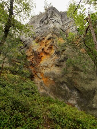 geologists: Sandstone rock tower. Czech Paradise national park