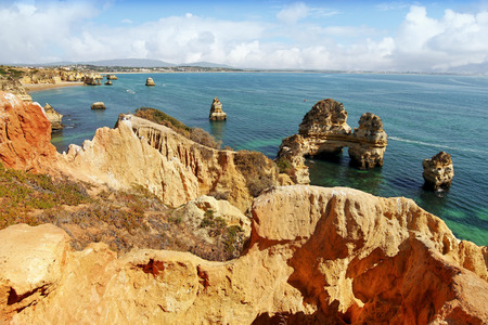 Algarve Portugal. Wild yellow rock cliffs and green-blue ocean Stock Photo