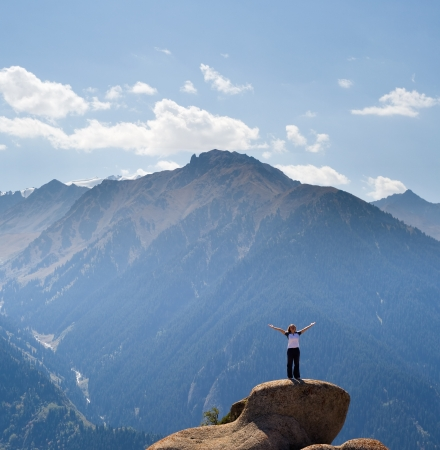 meditating woman: Yoga at summit with aerial view of the mountain range