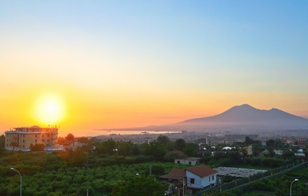 Picture of sunset in silhouette against a background of Pompeii Vesuvio volcano, Italy. photo