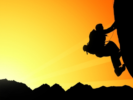 Silhouette of climbing young adult at the top of summit with aerial view on mountain range and sun ray photo