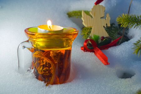Christmas time, glass of mulled wine with angel for card on the white background having much copyspace photo