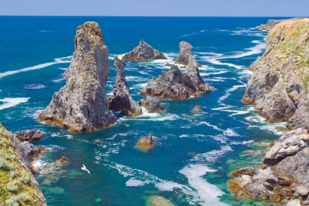 belle: The image of the famous places on the island Belle Ile en Mer - Aiguilles de Port-Coton with the waves pounding on the rocks, each of which has its name from its shape  Stock Photo