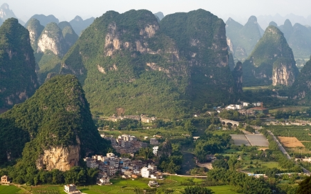 Aerial view image of Guilin village at sunset from Moon Hill mountain  Yangshuo, China, Asia photo